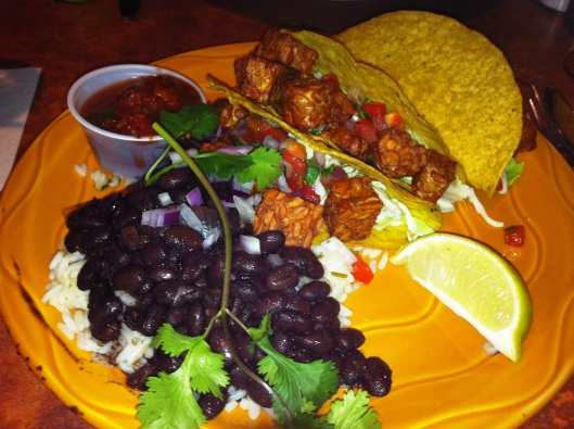The fried tempeh tacos with a side of flavorful black beans and rice