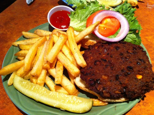 The scratch-made green chile, black bean, and corn burger with a side of fries