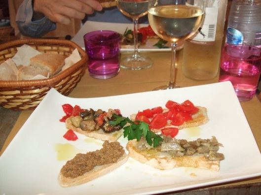 A delightful appetizer of different types of bruscetta