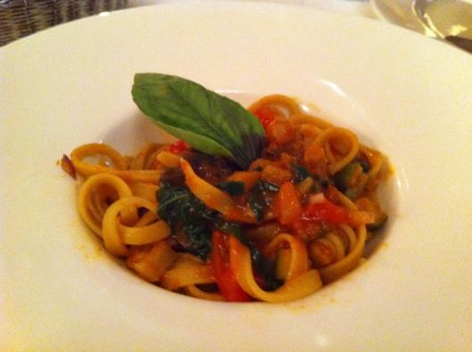 Pasta dish bursting with fresh basil flavor at La Trattoria in Perugia.
