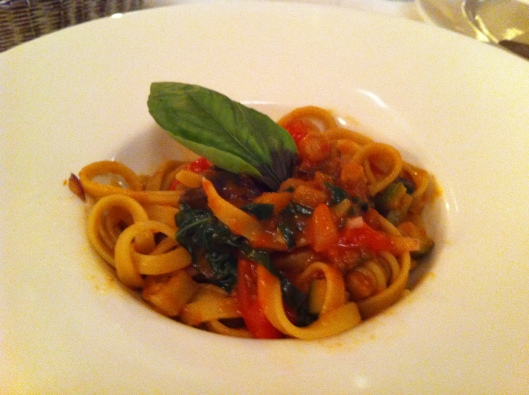 Pasta dish bursting with fresh basil flavor at La Trattoria in Perugia.