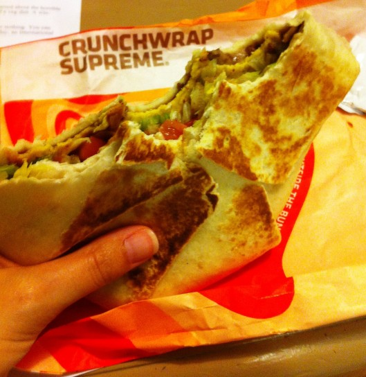 Yep, that's a Taco Bell Crunch Wrap Supreme, minus beef, add beans, no cheese, no sour cream.