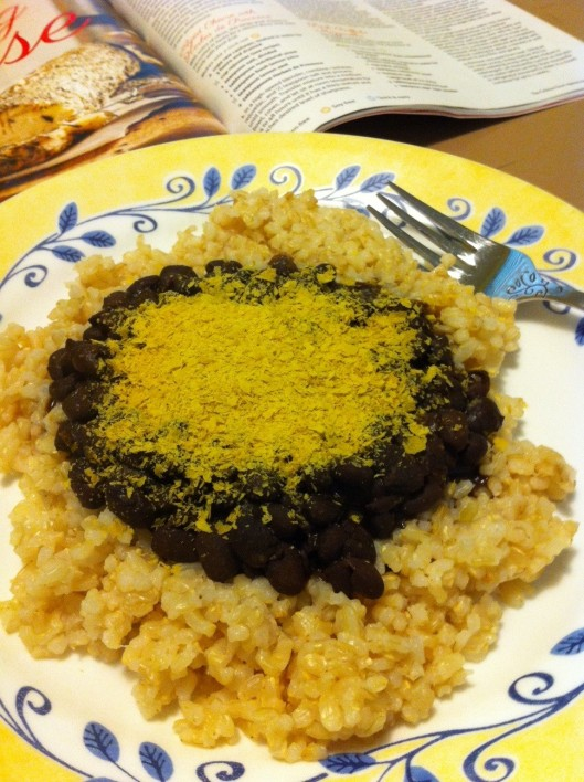 Here's nutritional yeast sprinkled (generously) on black beans and rice.
