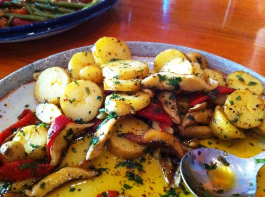 Fingerling potatoes with wild mushrooms and peppers in olive oil. SO flavorful!
