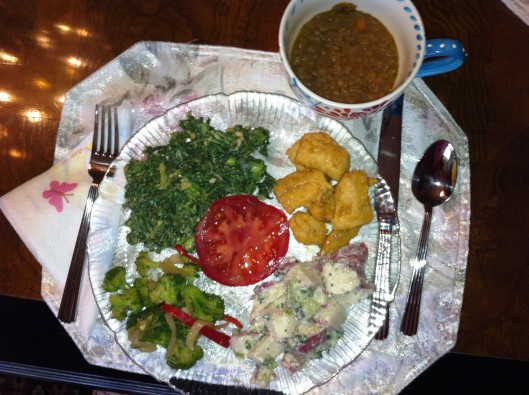 "Lentil soup, Gardein Mandarin ""Chik'n,"" vegan potato salad, broccoli salad, garlicky kale, and a fresh, sweet tomato."