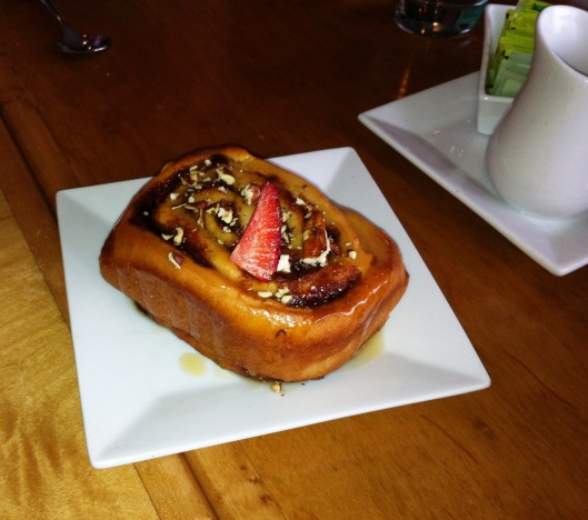 And the incredible Cinnamon Roll with warm almond glaze, pecans, and a strawberry!
