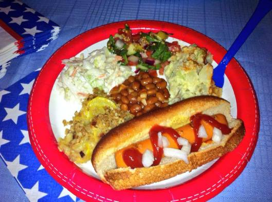 Vegan hot dog, cole slaw, potato salad, squash casserole, baked beans, and gazpacho salad!