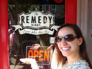 Sarah with Remedy sign