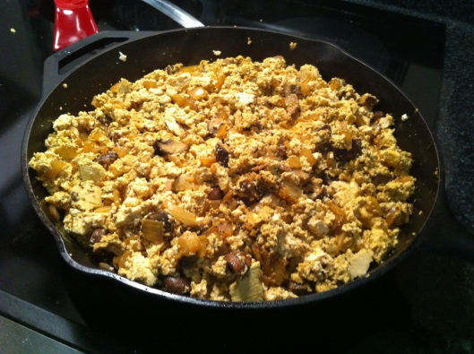 Sizzling tofu scramble in the cast iron skillet