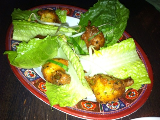Bahn He: Chive and scallion fritters w/ sprouts, herbs in lettuce. (Ask for no fish sauce on the side to make it vegan!)