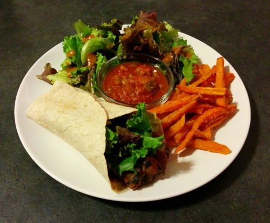 Travis' MM Dinner: Homemade bean burrito with red and black beans sauteed with garlic and chili powder then lightly mashed. Served with a salad with ginger dressing, sweet potato fries, and salsa!