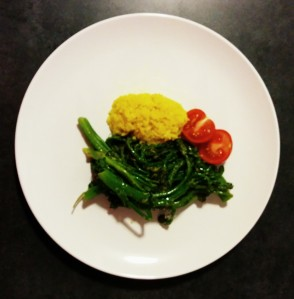 MM Dinner at Travis': Broccolini sauteed with margarine, onion, garlic, salt and lemon juice, with yellow rice and tomatoes!